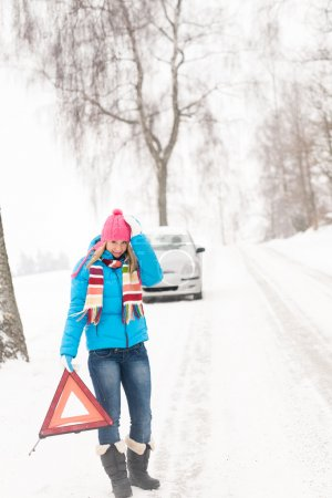 Photo for Woman with reflector triangle car snow breakdown problem winter traffic - Royalty Free Image