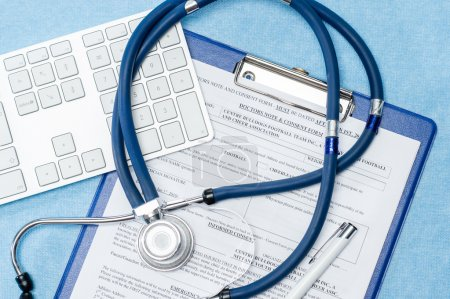 Photo for Stethoscope laying over doctors emergency report medical documentation - Royalty Free Image