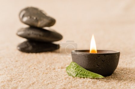 Spa still life candle with zen stones