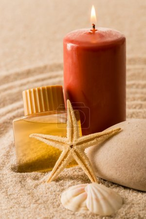 Spa setting candle with oil seashell star
