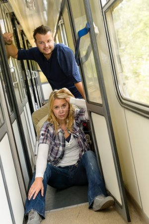 Woman and man sitting on train hallway