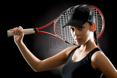 Tennis woman sport hold racket on black