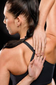 Young woman stretching her arms and back