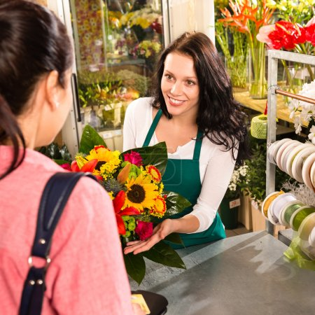 Photo for Colorful bouquet florist woman selling customer flower shop store - Royalty Free Image