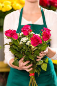 Female holding bouquet flowers roses flower shop