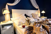 Rumpled sheets hotel bedroom romantic night