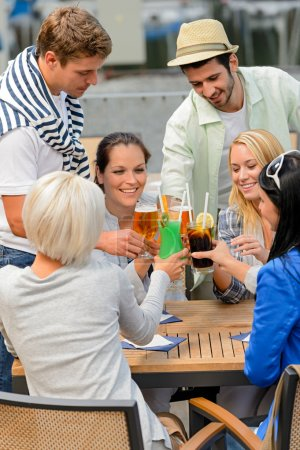 Group of cheerful toasting with cocktails