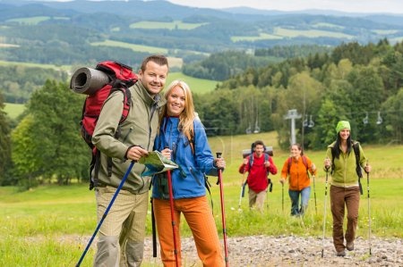 Posing hiker couple with landscape background