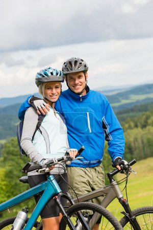 Sporty couple enjoying fresh air bicycles nature