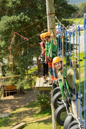 Climbing visitors in adventure park