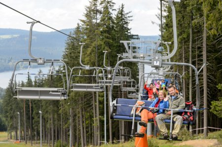 Waving young sitting on chairlift