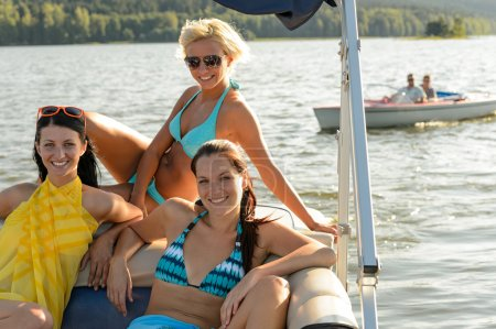 Young women sunbathing on boat