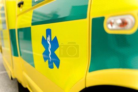 Paramedic symbol on yellow ambulance car