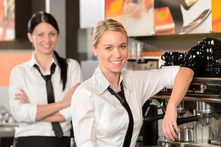 Photo for Two waitresses posing in coffee house in uniform - Royalty Free Image