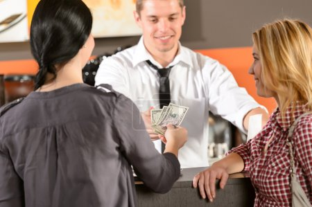 Female customers paying by cash USD bar