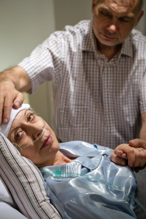 Loving husband taking care of sick wife