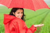 Lively teenager girl in the rain