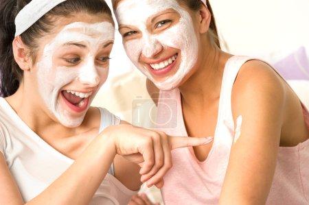 Caucasian girls wearing peeling mask having fun