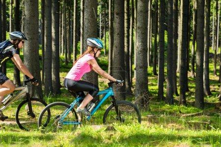 Sporty biking couple in woods