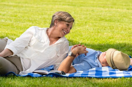 Elderly couple enjoying relax time in park