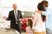 Salesman selling car to family