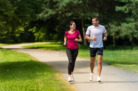 Photo for Cheerful Caucasian couple friends running in park - Royalty Free Image