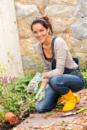 Woman gardening autumn flowers yard housework
