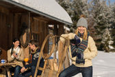 Young woman spend holiday winter show cottage