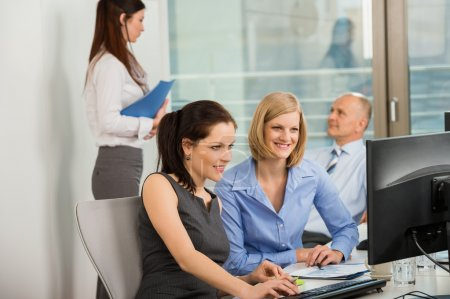 Businesswomen Using Computer In Office