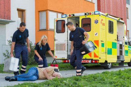 Paramedical team arriving to unconscious man