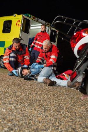 Emergency team helping injured driver