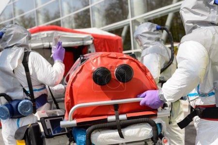 Biohazard team pushing stretcher