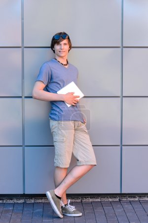 College student boy with tablet