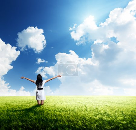 Photo for Happy young woman in white dress standing at field - Royalty Free Image