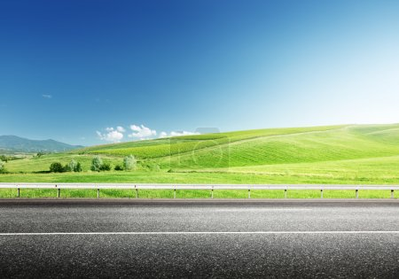 Photo for Asphalt road and perfect green field - Royalty Free Image