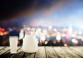 glass of milk and night city