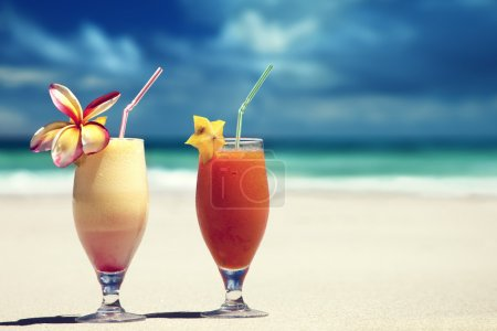 Photo for Fresh fruit juices on a tropical beach - Royalty Free Image