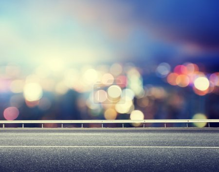 Photo for Asphalt road and blurred modern city - Royalty Free Image