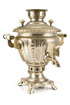 Old russian tea samovar isolated on white...