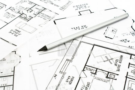 House plan blueprints with drawing pencil