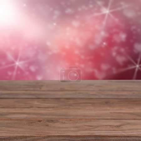 Pink background with heart and old table