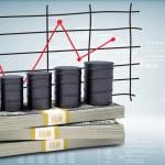 Barrels oil stand on pack of dollars. Schedule pri...