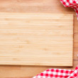 Empty wooden cutting board and cloth red napkin...