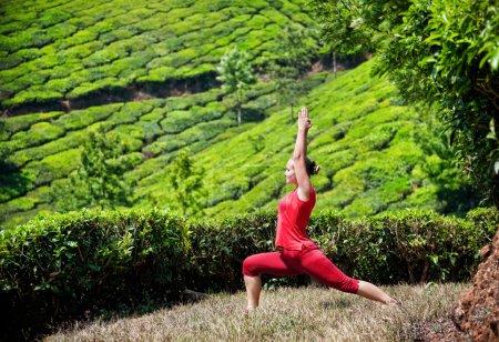 Yoga warrior pose in tea plantations