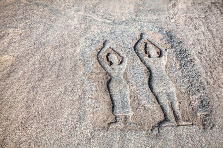 Stone with yoga people in Hampi
