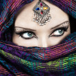 Portrait of beautiful woman wrapped in scarf with ...