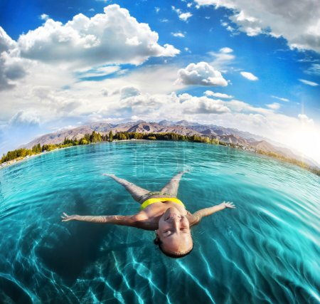 Woman swimming in the mountain