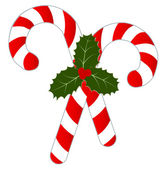Two candy canes with Holly decoration isolated on a white background