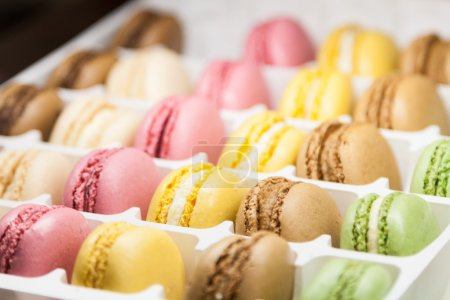 Photo for Variegated sweet macaroons in box - Royalty Free Image