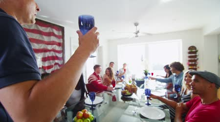 Family and friends raise glasses for toast